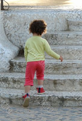 the child rising on steps