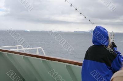 Cruise ship tourist in blue parka