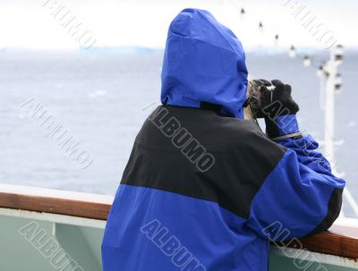 Cruise ship tourist in blue parka