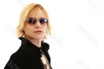 Woman in sunglasses and furry coat