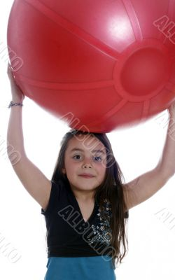Young girl with an exercises ball
