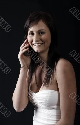 young woman calling by cellular phone