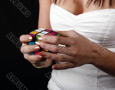 girl solving rubik cube