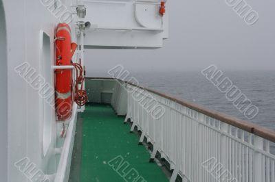 Cruise ship, life preserver, in calm seas