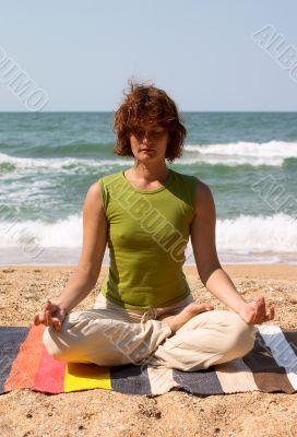 girl meditating on the seaside