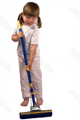 Upset little girl with mop