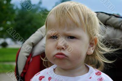 Unhappy child in pram