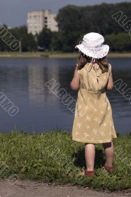Little girl looking away on the back of a river