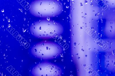 Abstract vivid blue background with waterdrops