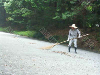 street cleaner at Morning in Tokyo garden