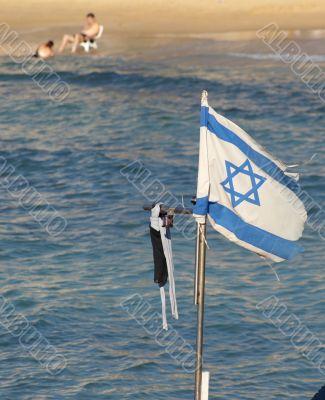 Israel state flag on a beach