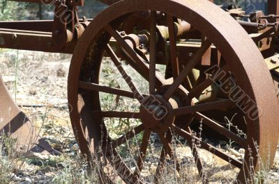 Old wheel  - a part of rust plow