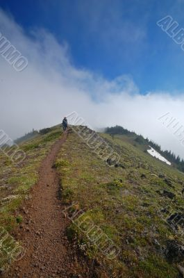 Man hiking on a trail in the mountains