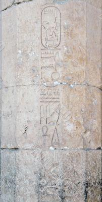 carved hieroglyph writing