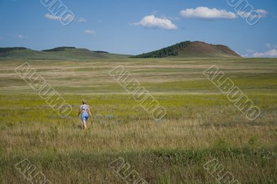 Single woman in steppe