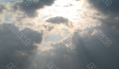 sunlight rays shining through the sky
