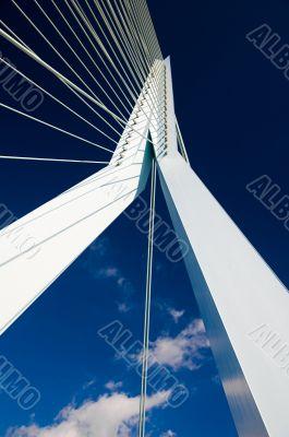 Abstract view on big white suspension bridge