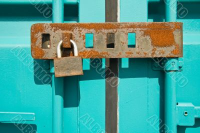 Rusted padlock on freight container closeup