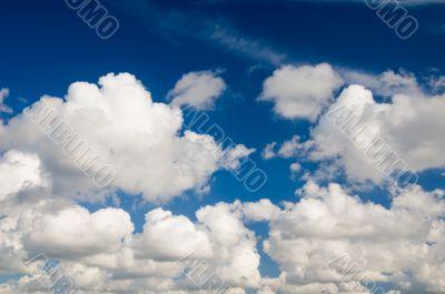Cloudscape. White clouds in the blue sky.