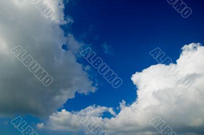 big white fluffy clouds in a deep blue sky