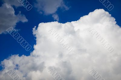 huge white fluffy cloud in a deep blue sky