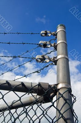 chain link fence with barbed wire on top