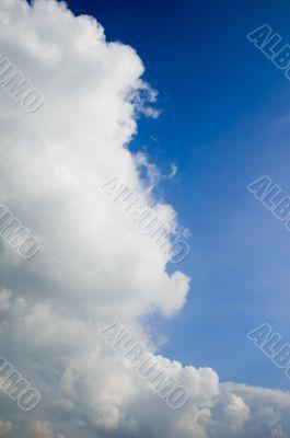 huge cumulus cloud in a bright blue sky