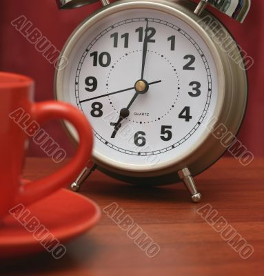 Coffee cup and alarm clock