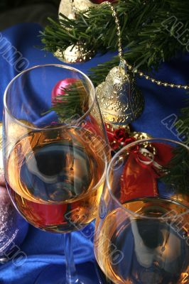 Glass of white wine on a beautiful christmas background