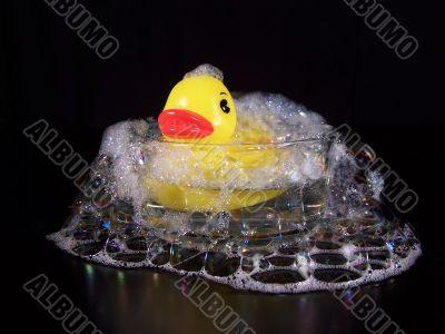 Yellow Rubber Duck In A Small Bubble Bath