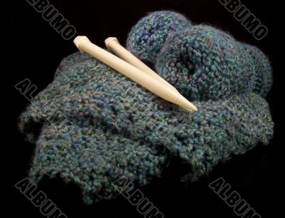 Knitting Supplies In A Basket With Needles
