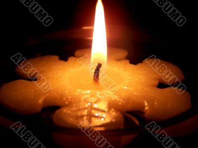 Burning Snowflake Candle Close Up