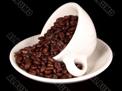 Cup Of Coffee Beans On Saucer