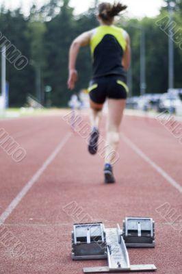 a woman is taking hurdles