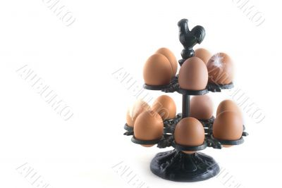 many brown eggs in a rack