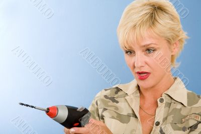 blond model in studio with cordless drill