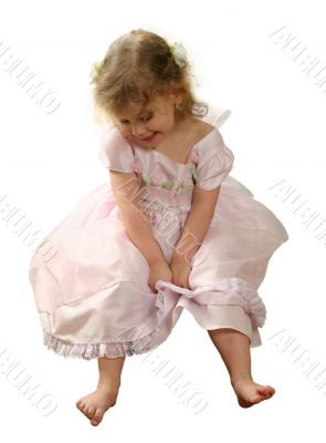 Small girl in pink gown on white background.