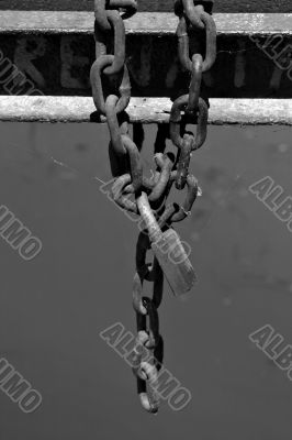 Rusted chain with padlock