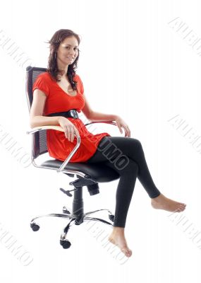 Satisfied businesswoman sitting down