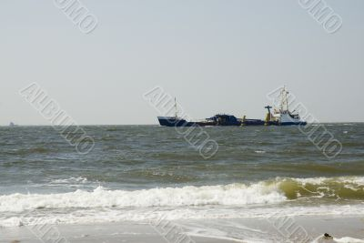 Cargo-boat near the coast