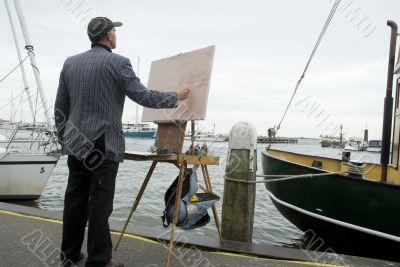 painter in harbor