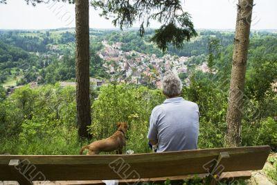 Man and dog at viewpoint