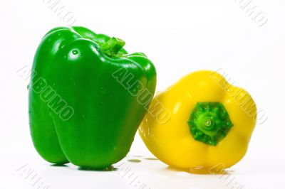 The isolated green and yellow peppers