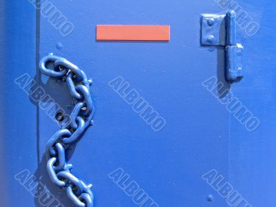 Blue door with chain
