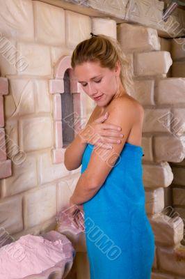Scrubbing her skin