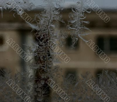 Closeup Ice Pattern on Window with Transparent Opposite House Fragment