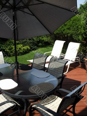 Suburban home backyard with patio furniture