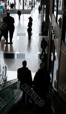 Silhouette Of Customers On Escalator