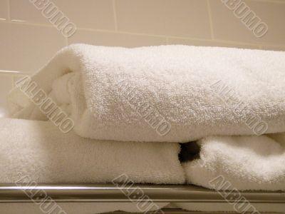 A Pile Of Folded Plush Towels