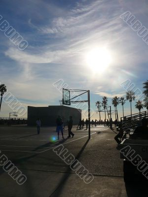Beachside Basketball Game at Dusk